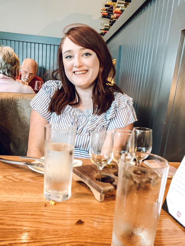 Woman eating at Louvino restaurant in Louisville, Kentucky.