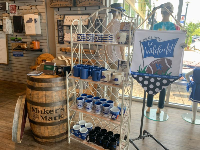 Rack of Kentucky themed mugs, a Maker's Mark bourbon barrel and a Go Wildcats flag at the Kentucky Branded store in Lexington, Ky. Where to shop in Lexington.