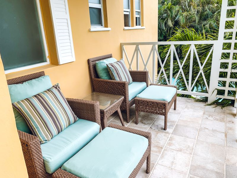 Rooms at the Royal Hideaway Playacar include spacious terraces with two comfortable chairs surrounded by lush foliage.