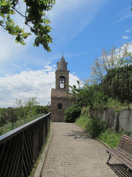 Fiorenzuola di Focara: the old church with the bell tower