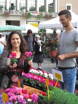 Me proudly showing newly bought cyclamens at St. Francis Flower Fair in Pesaro