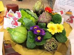 Table decoration with vegetables and primroses