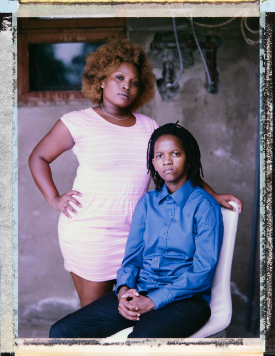"Claudia (left), a 24 year old lesbian woman, and Jo (right), a 31 year old transgender man, have been in a relationship for over five years. Jo explains what happened when Claudia's mother discovered their relationship: ""she was expelled from the house and I had to take responsibility and take Claudia to live with me at my parents' house."" Jo's family took in Claudia, two weeks later her family began to soften. Jo says: ""Claudia's mother asked her to come back home and expressed an interest in getting to know my family, this is what happened in the same year. From that period until here, both her family and my family, our relationship is being respected by all of them."" Mozambique, Maputo. 22 February, 2018. Photo Robin Hammond/Witness Change"
