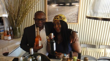 Stanley Egubchulam and associate displaying the goods at the VIP room at Amali