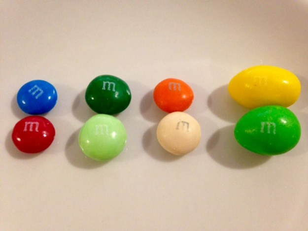 M&Ms from left to right:  Plain, Mint, Pumpkin Spice Latte Horror, Almond