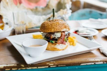 hamburger on plate at restaurant