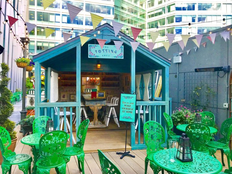 The potting shed at fight club rooftop bar with bunting around it