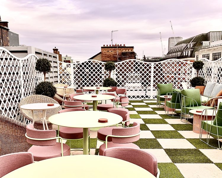 Pink and green diner chairs on the Wing rooftop cub