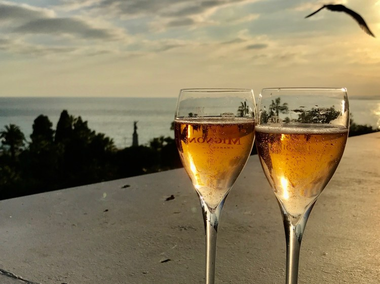 2 champagne glasses on a rooftop bar in Nice, France