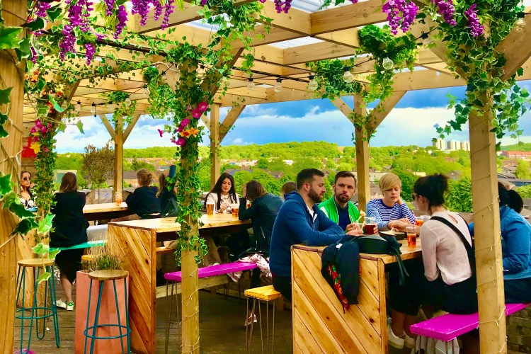 Bussey rooftop flowery filled bar pink flowers