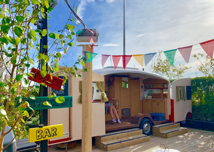 Caravan and bunting on a rooftop