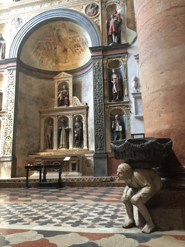 Sant'Anastasia with one of two hunchback statues supporting a holy water font