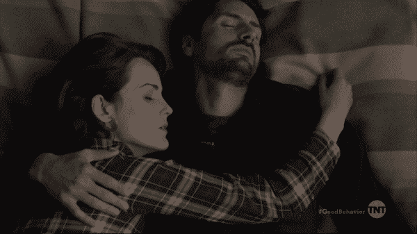 Letty and Javier sleeping together lovingly.