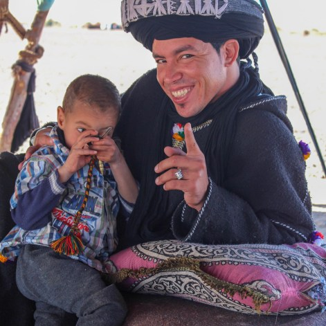 Our driver Mohamed holding a Berber Child