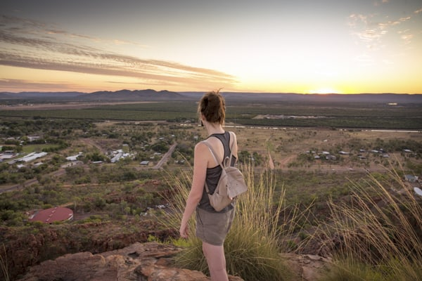 young lady on a hill top looking over Kununurra in the Kimberley at sunset