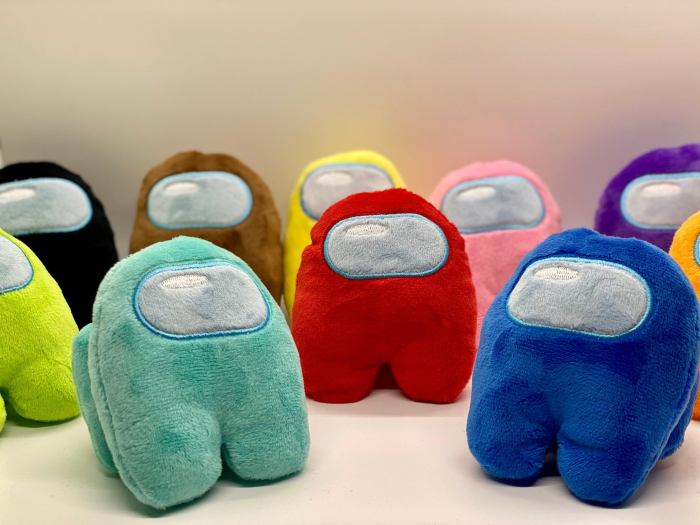 Colorful alien-robot plushies in a semi circle