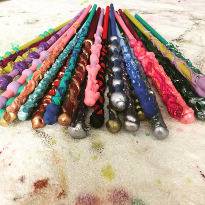 A stack of colorful wands inspired by Harry Potter