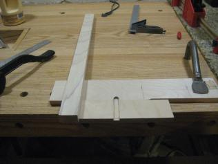 After the glue dried, screws were driven and the router was used to create a dado in scrap.