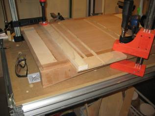 The jig is clamped into place by aligning the center of the jig's dadoe to the center mark from the story stick.