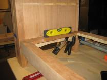 Using a level to make sure the web frame wasn't canted, I glued on the supports with spring clamps.