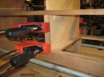 Gluing on center stiles to cover exposed plywood.