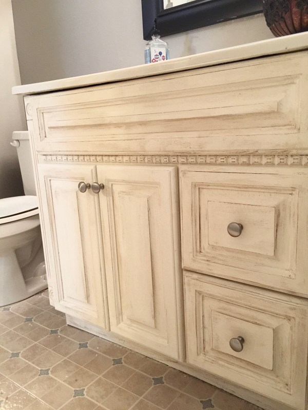 Another oak vanity bites the dust! Check out this beautiful, simple, and inexpensive makeover to this blogger's basement guest room bathroom vanity!