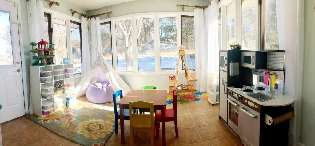 Turning a sunroom into a playroom: We loved our gorgeous sitting room in our sunroom right off of our kitchen, but making it into a playroom for our young kids was much better use of the space. Now they can happily play in all of that direct sunshine while we are nearby to watch. We love our playroom sunroom!