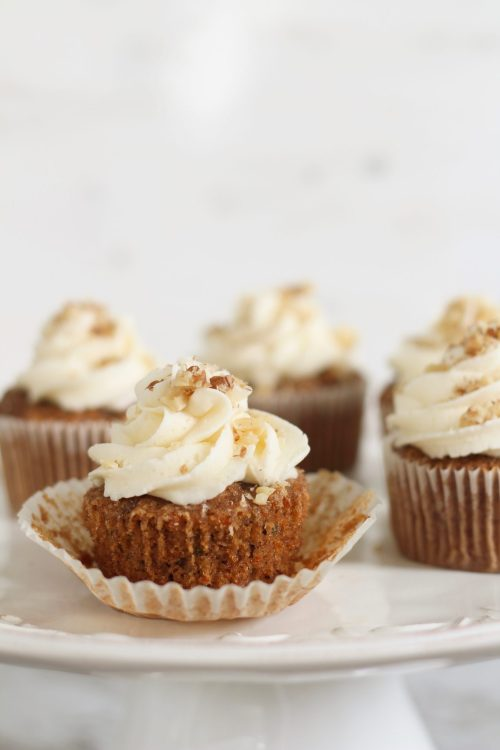 This carrot cake cupcakes recipe is the best, most easy recipe from scratch and will be your next go-to recipe every time you need to make a dessert for a loved one. The minced carrots make them incredible moist, and the homemade buttercream icing is literally the icing on top. Forget making cakes for your next holiday event or birthday from a box. Cakes from scratch take home the gold medal! You can make full sized cupcakes or minis; Either are delicious and crowd pleasing!