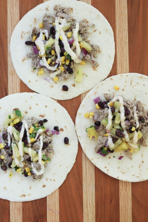 These shredded pork tacos are topped with a homemade pineapple salsa and drizzled with a store-bought queso dip. They're insanely flavorful & perfect for a weeknight or weekend dinner. Ready in 30 minutes, you'll be adding this to your frequently dinner rotation. Click for the full recipe!