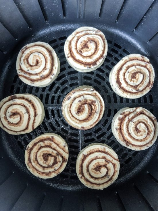 Air Fryer Cinnamon Rolls: This quick and easy breakfast recipe helps get breakfast on the table in five minutes flat! No more waiting for the oven to preheat and long cook times. Just plopped them in the air fryer, set the temperature, and get your plates ready! You'll never cook Pillsbury cinnamon rolls another way! Full details on WhimsicalSeptember.com