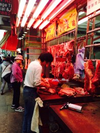 Chopping meat on the street.