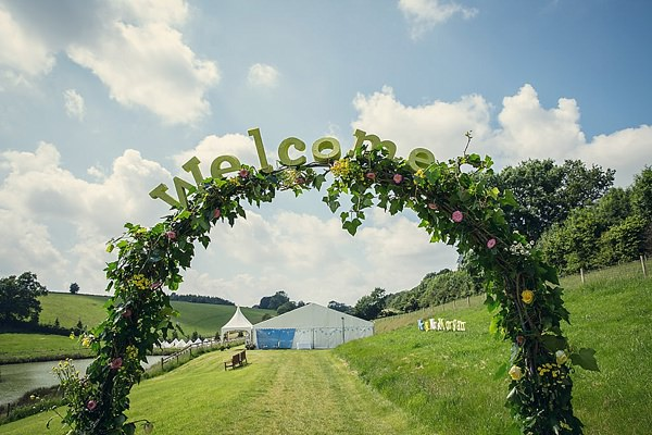 Fun Kid Friendly Colourful Party Wedding Welcome Sign Flower Arch  http://assassynation.co.uk/