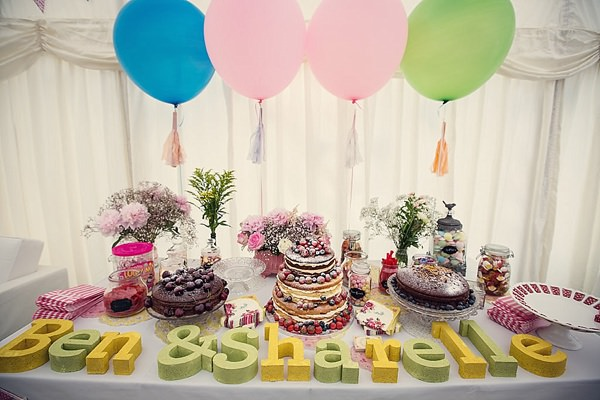 Fun Kid Friendly Colourful Party Wedding Cake Sweet Table Tassel Balloons http://assassynation.co.uk/
