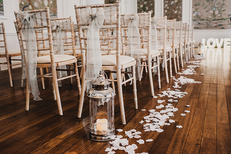 White Chairs Aisle Decor Petals Candles Glamorous Gatsby 1920s Speakeasy Winter Wedding http://www.jmcsweeneyphotography.co.uk/