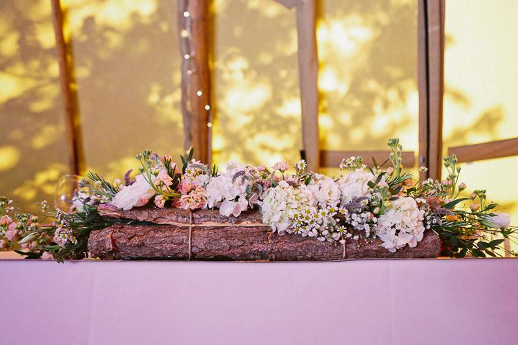Log Flower Bark Tree Top Table Arrangement Rustic Laid Back Tipi Wedding http://helenrussellphotography.co.uk/