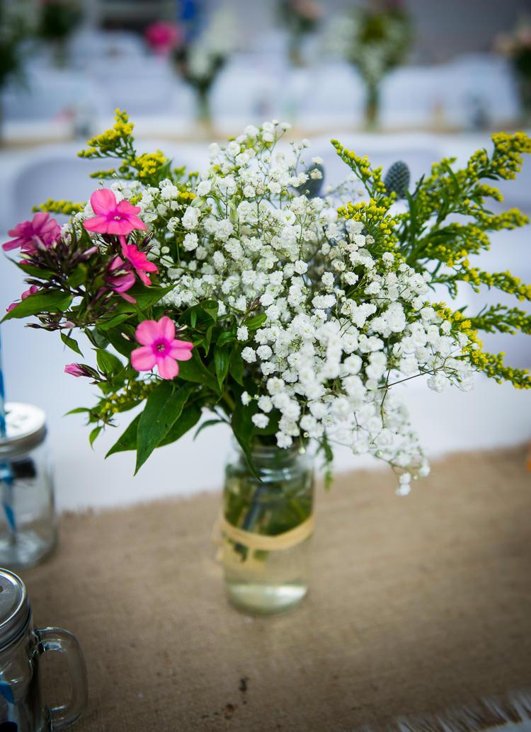 Jar Flowers Raffia Colourful DIY Village Fete Wedding http://jamesgristphotography.co.uk/blog/