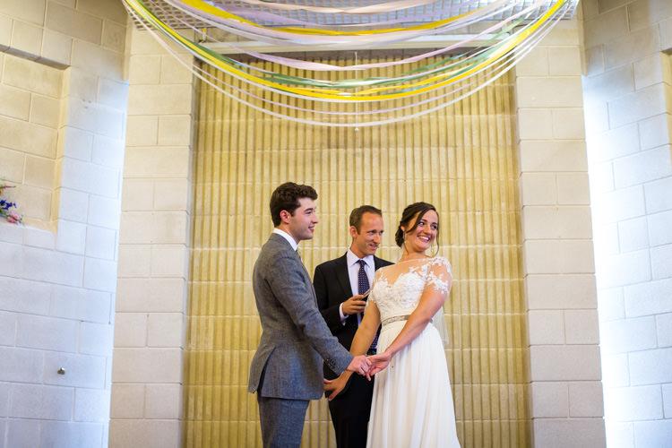 Streamer Ribbons Backdrop Ceremony Colourful DIY Village Hall Wedding http://samanthagilrainephotography.com/