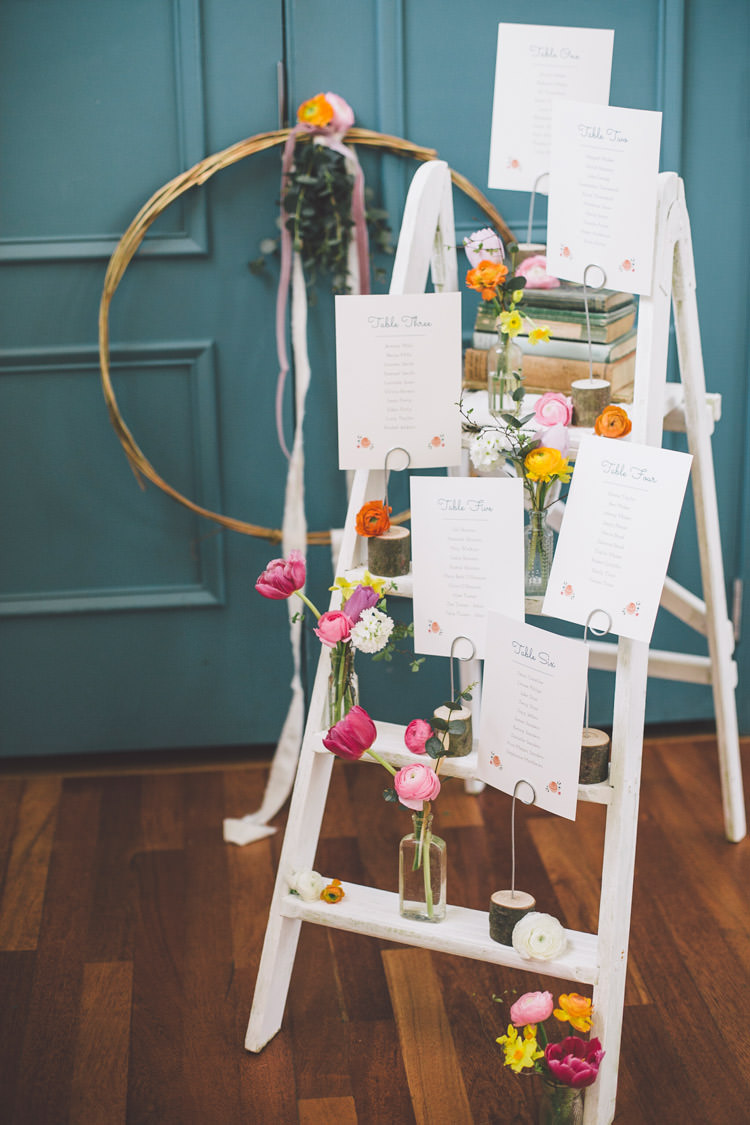 Ladder Seating Table Plan Chart Flowers Bottles Books Spring Time Chic Wedding Ideas http://graceelizabethphotography.com/