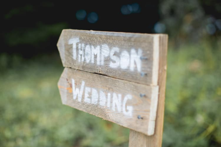 Wooden Rustic Sign Post Family Farm Festival Wedding https://amylouphotography.co.uk/