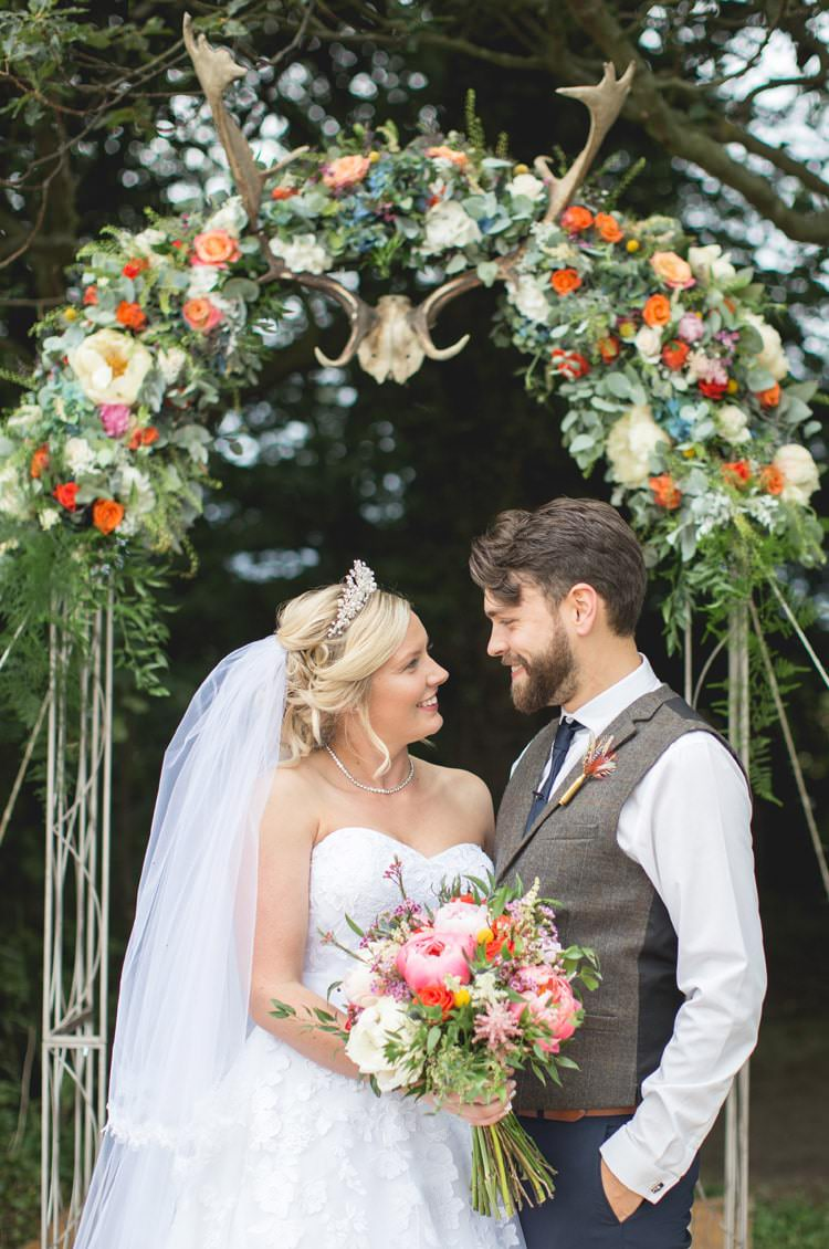 Arch Backdrop Flowers Antlers Family Farm Festival Wedding https://amylouphotography.co.uk/