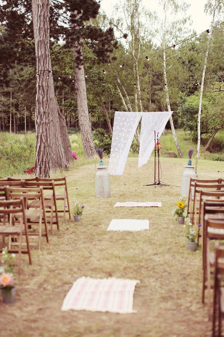 Aisle Ceremony Lace Backdrop Outdoor Mismatched Fairground Woodland Wedding http://www.rebeccaweddingphotography.co.uk/