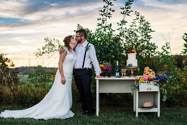 Dessert Table Wedding Cake Donuts Wine Decorated With Multicoloured Florals Brown Glass Vases Bride Lace Bridal Gown With Buttons Groom Navy Pants Suspenders Cream Bow Tie Buttonhole Ethereal Boho Wedding Ideas http://perfectcapturephoto.com/