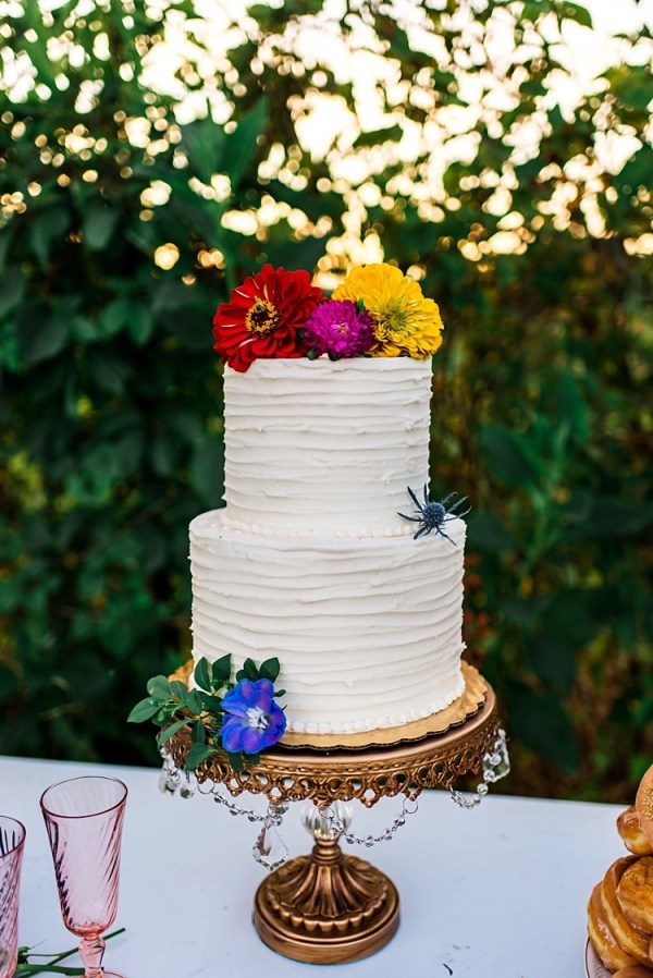 Wedding Cake Multicoloured Florals Red Yellow Pink Purple Delphinium Gerbra Gold Stand Ethereal Boho Wedding Ideas http://perfectcapturephoto.com/