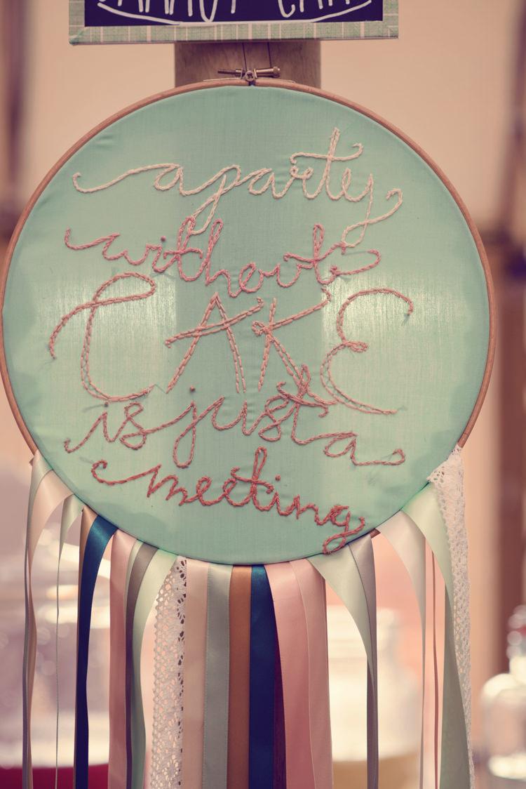 Embriodery Hoop Cake Sign Homespun Mint Yurt Wedding http://www.jessicaraphaelphotography.com/