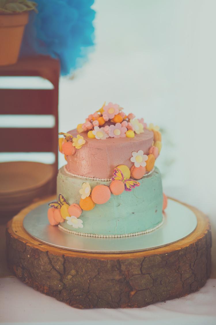 Buttercream Pastel Macaron Cake Log Colourful Woodland Humanist Wedding http://sashaweddings.co.uk/