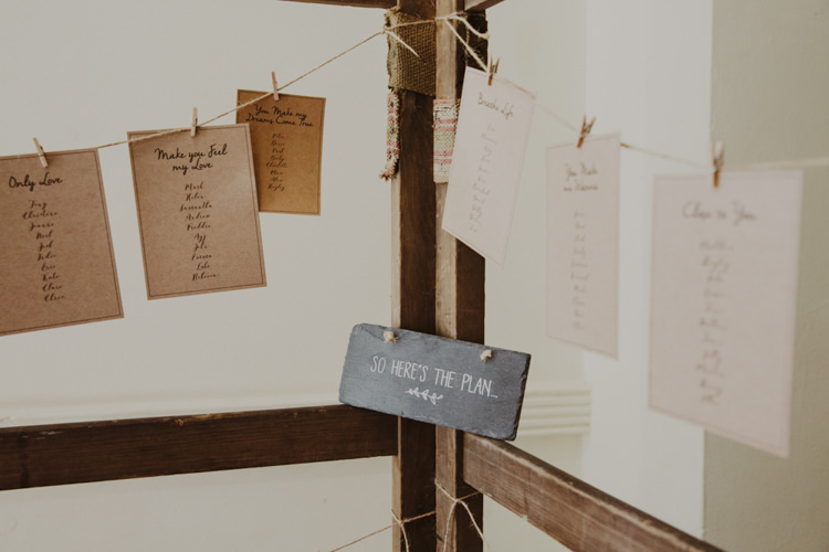 Seating Table Plan Chart Wooden Frame Pegs Twine Romantic Stylish Relaxed Sea Wedding http://www.oxiphotography.co.uk/