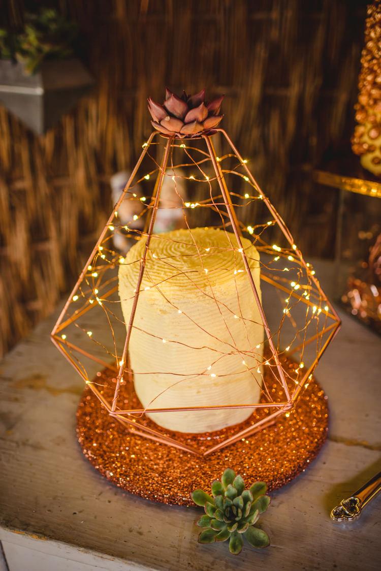 Copper Rose Gold Cake Fairy Lights Magical Fun Outdoor Barn Wedding http://www.sophieduckworthphotography.com/