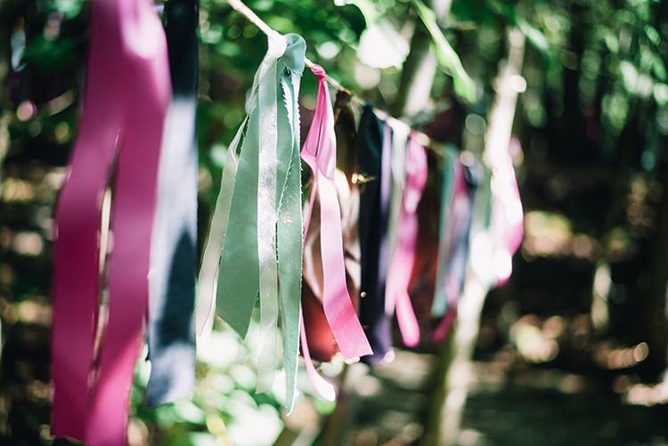 Outdoor Ceremony Hanging Décor Multicoloured Ribbon Bunches Trees Woodland Waterfall Mint Wedding Ontario http://www.laurenmccormickphotography.com/