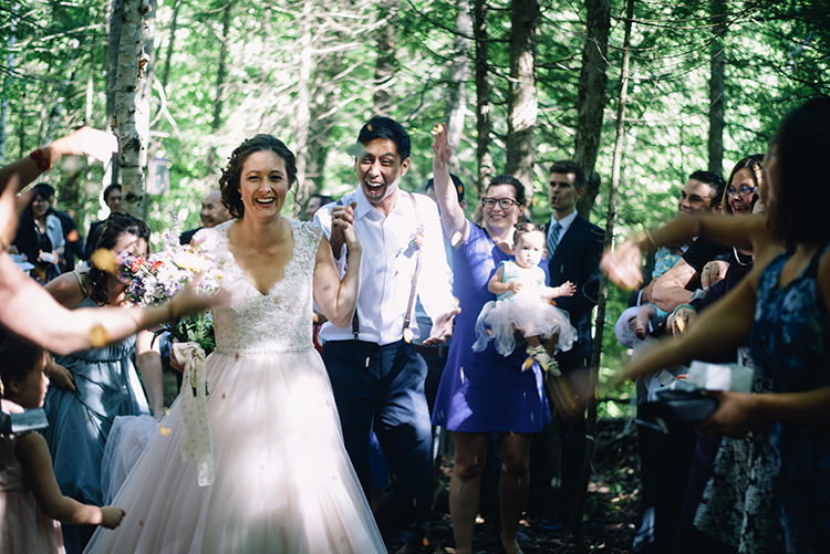 Outdoor Ceremony Just Married Bride Allure Champagne Lace Tulle Bridal Gown Groom White Shirt Brown Leather Suspenders Guests Confetti Woodland Waterfall Mint Wedding Ontario http://www.laurenmccormickphotography.com/