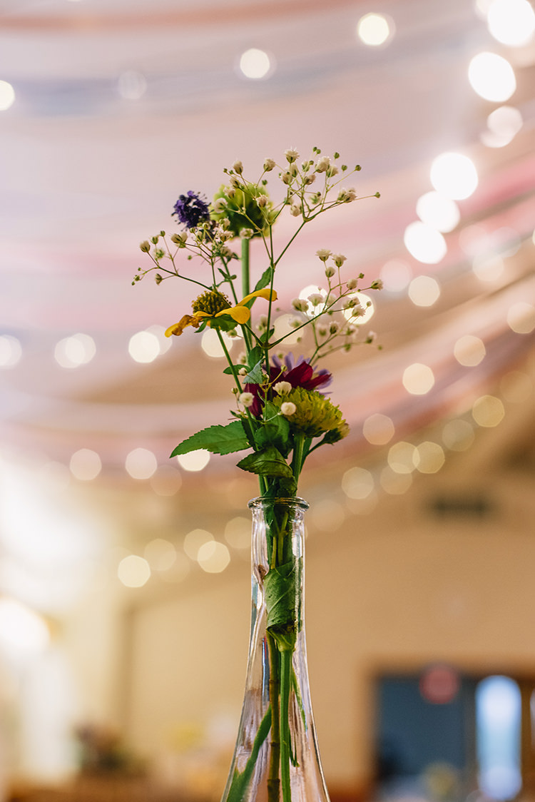 Reception Multicoloured Florals Yellow Purple Pink Daises Gypsophila Tall Glass Vase Fairy Lights Woodland Waterfall Mint Wedding Ontario http://www.laurenmccormickphotography.com/